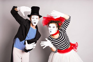 Waist-up portrait of funny mime couple with white faces. April Fools' Day - concept