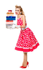 Full body of woman in pin-up style red dress with gift boxes, is