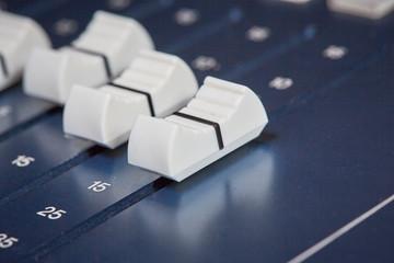 Closeup of faders of a mixing desk