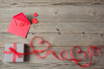 Gift box red ribbon and heart on Valentine's Day