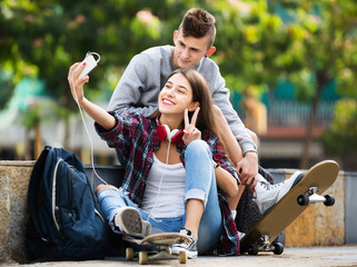 Teenagers taking selfie with smartphone