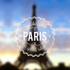 Paris typographic design on blurred Eiffel tower background
