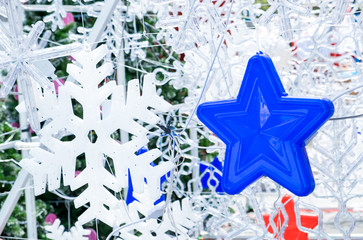 Close up blue star hanging with snowflake ,Holiday concept