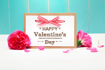 Valentines day message with pink carnations