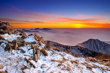 Wall Mural - Winter landscape with sunset and foggy in Deogyusan mountains.