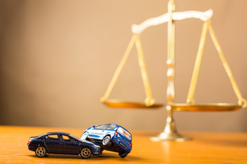 Car accident justice concept with justice weight background