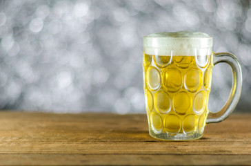 cold beer glass on table  with bokeh