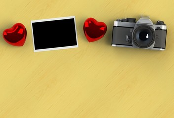 top view image of red heart , blank photo and vintage photo camera on yellow wood background. valentine's day celebration concept.