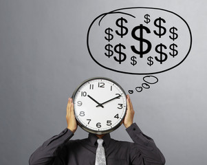 Businessman is holding clock  of head