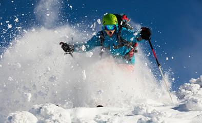 Man freerider running downhill