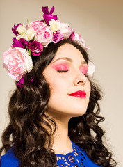 brunette with a flower wreath in her hair