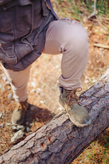 Hiker standing on tree trunk