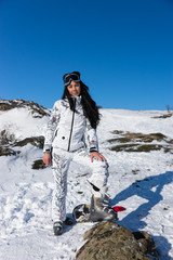 Woman in Ski Wear at Snow Looking at the Camera