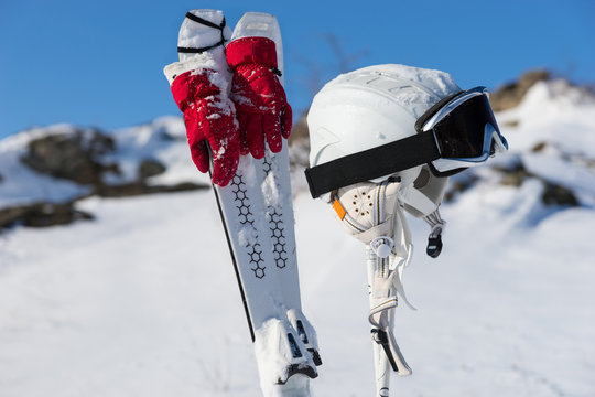 Gloves, poles and headgear for skiing theme