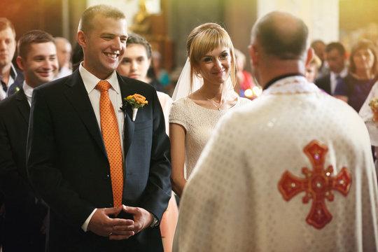 gorgeous romantic happy bride and groom having wedding ceremony