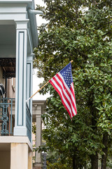 Traditional southern homes with American flags