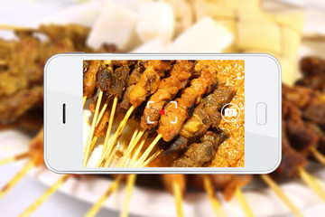 Taking food photo with smartphone.
