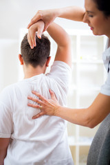 Chiropractor doing adjustment on male patient