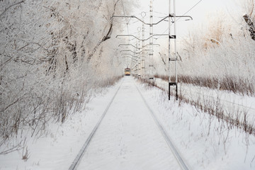 Tram and tramlines in Russia at winter with snow
