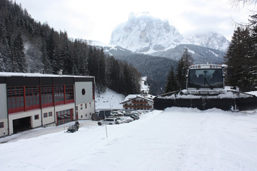 Dolomites skiing resort. Snowcat. Snow remover equipment.