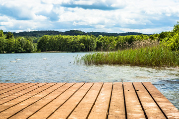 Landscape of wooden pier over beautiful lake in the summer