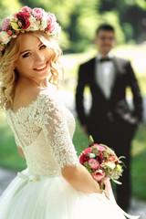 Gorgeous blonde smiling emotional bride in vintage white dress i