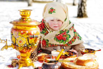 baby girl in a scarf on the head with a floral print. Portrait o