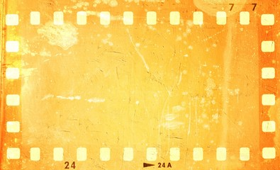 Grunge orange film strip frame.
