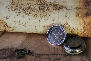 Compass on vintage map. Retro style.