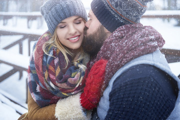Kissing couple in winter day