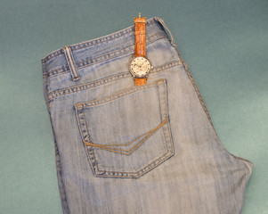 Youth jeans with a watch pocket on blue background