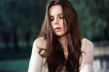 Portrait of a beautiful young brunette woman with long hair, lifestyle