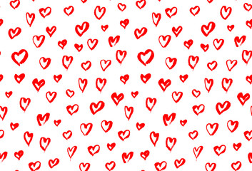 Seamless background pattern with hand drawn textured red hearts
