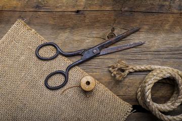 Old scissors on wood