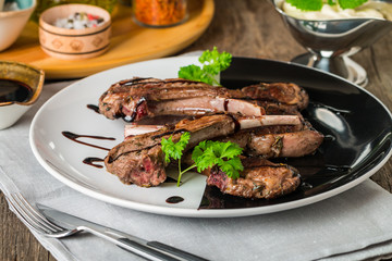 Grilled lamb ribs with sauce