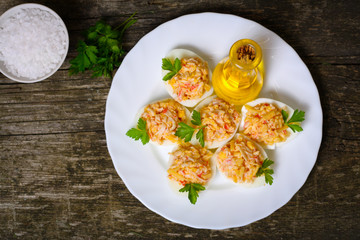 Eggs stuffed with crab and cheese on a wooden table