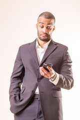 surprised man reading sms on cell phone