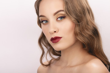 Closeup studio portrait of young fashionable woman with trendy gorgeous makeup