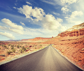 Vintage stylized scenic road without lanes, USA.