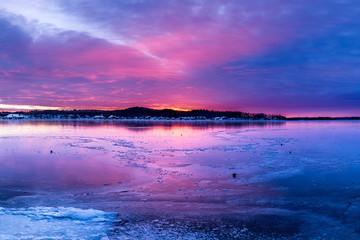 Colorful Sunrise over frozen lake.