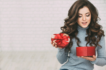 Beautiful woman open red gift box heart.