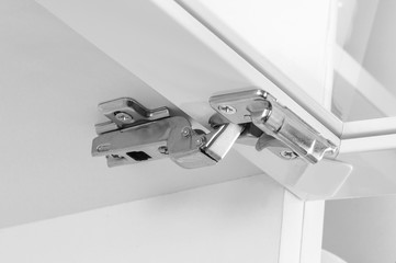 Closeup of furniture cabinet modern clip hinge with amortization