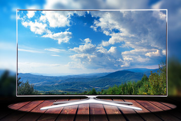 monitor isolated on wood