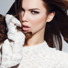 Expressive portrait of a beautiful brunette girl in the studio
