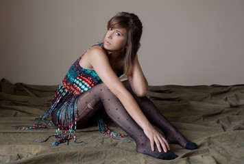 Woman in Fringed Top and Patterned Tights