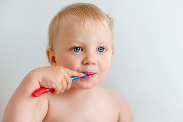 Blond little girl with tooth brush