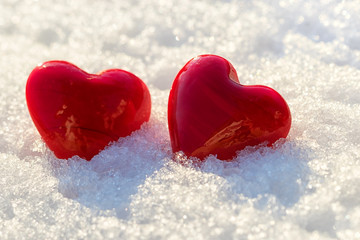 two red hearts on ice wet snow, selective focus, outdoors image
