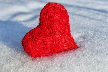red heart on ice wet snow, selective focus, outdoors image
