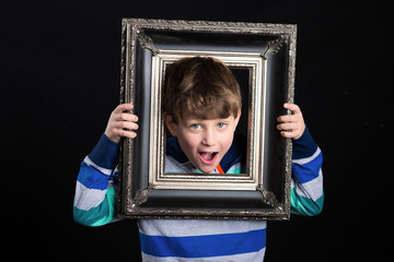 Boy holding picture frame