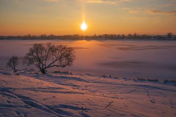 Warm freeze or fozen sun. Landscape at the river's bank